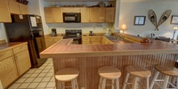 Kitchen with breakfast bar and coffee maker for those early mornings