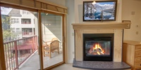 Living room with cozy fire and relaxing tv