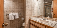 Bathroom with wallpaper and tiled floors