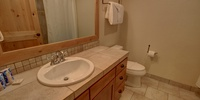 Shared bathroom with tub/shower combo.