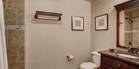 Bathroom with wall decor