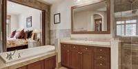 Bathroom with tiled floors