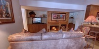 Living room with relaxing tv and cozy fire