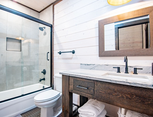 Kids Bunkroom full bathroom with a bathtub for the small children