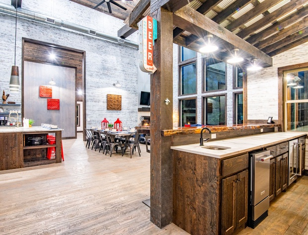 Live edge custom Bar perfect for entertaining! Open up the window to serve your guest on the Patio! Fully equipped with wine fridge, sink, and so much more!