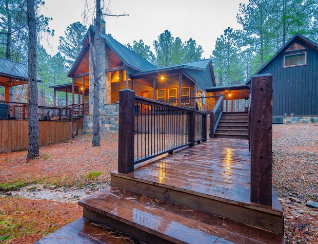 Enjoy the creek running below the custom deck bridge to the outdoor firepit