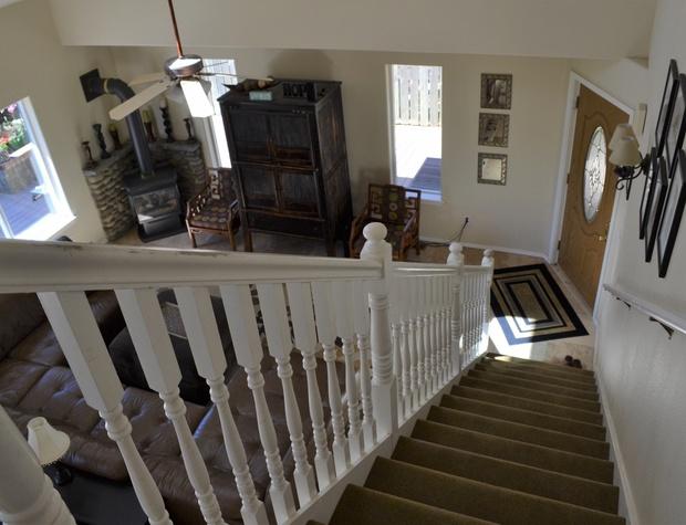 Front door at bottom of steps
