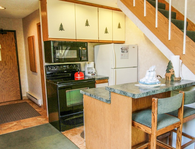 Small but well equipped kitchen is great for preparing meals during your stay.