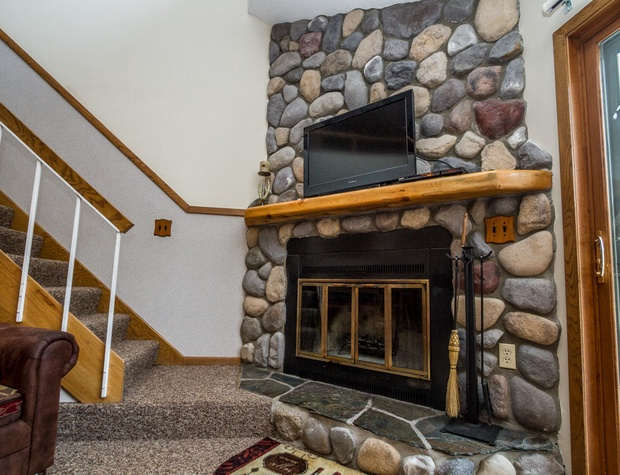 The wood burning fireplace is perfect for those cold winter nights after a long day on the slopes.