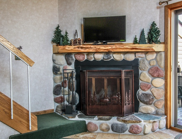 The stone surround wood burning fireplace is great on cold winter nights.
