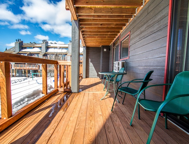 There are walk-outs from both the living room and bedroom onto the deck.