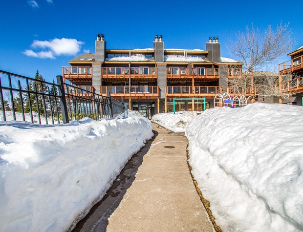 Whether you come in the winter or the summer, Caribou Highlands is a fun, family-friendly resort. Head into this building to find the fitness center.