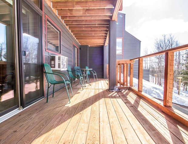 The deck expands the entire width of the unit.