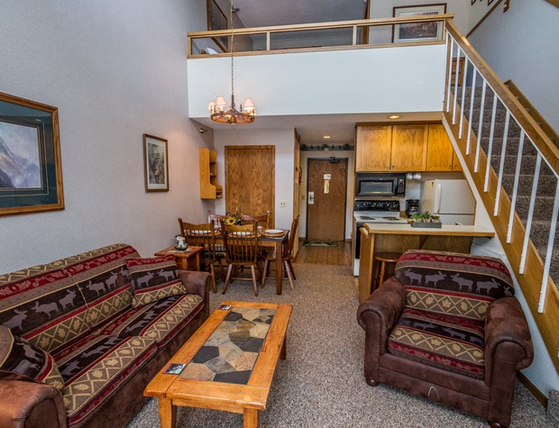 The living room area is open to the kitchen and dining area.