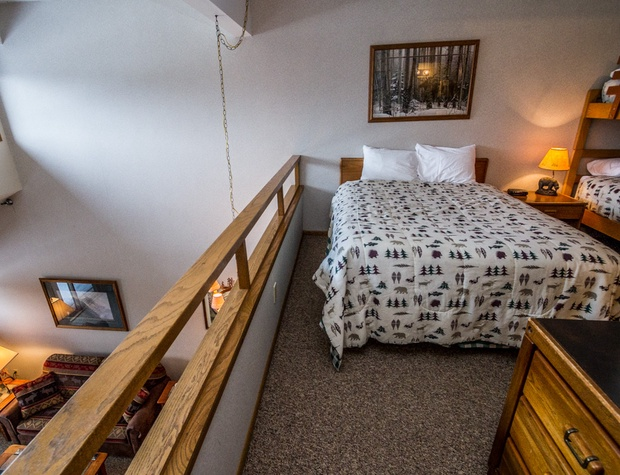 Open to the loft area below, this unit has no true bedroom but plenty of space for a group.