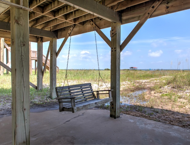 Swing in the shade and feel the gulf breeze