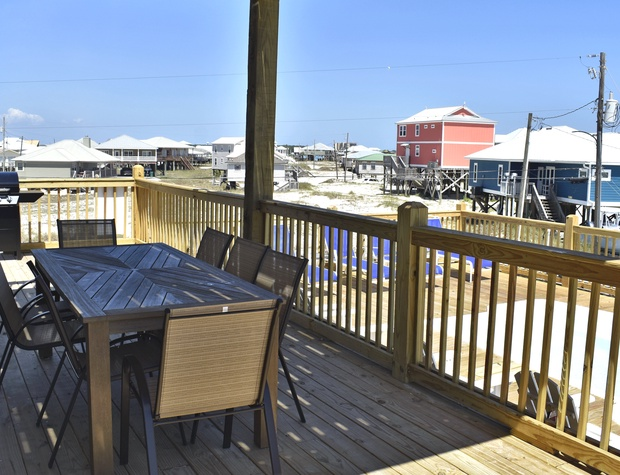06 Outdoor table and grill Island Time V Dauphin Island vacation rental.jpg