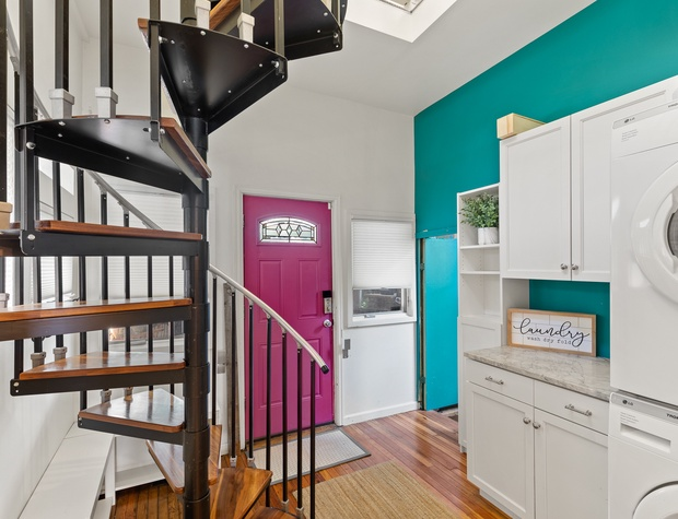 Rear Mudroom Entrance + Spiral Staircase to the 2nd Level