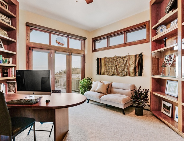 Study opening to balcony including a workspace, and queen futon (futon in photo has been updated)