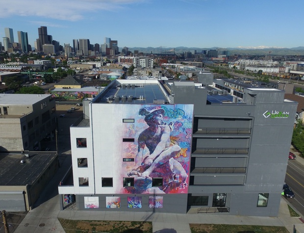 Denver Skyline with a Grand View of the Building and Mural on the building.