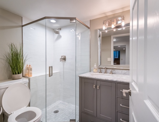 Full bathroom with walk-in glass shower on the lower level