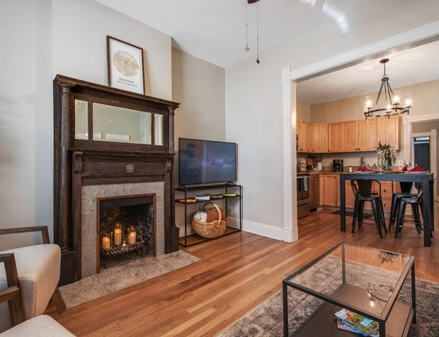 Living Room with Flatscreen TV (Fireplace is NOT operational) + Dining/Kitchen Area