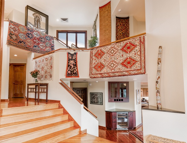 The house features a three-story atrium displaying my collection of Asian textiles