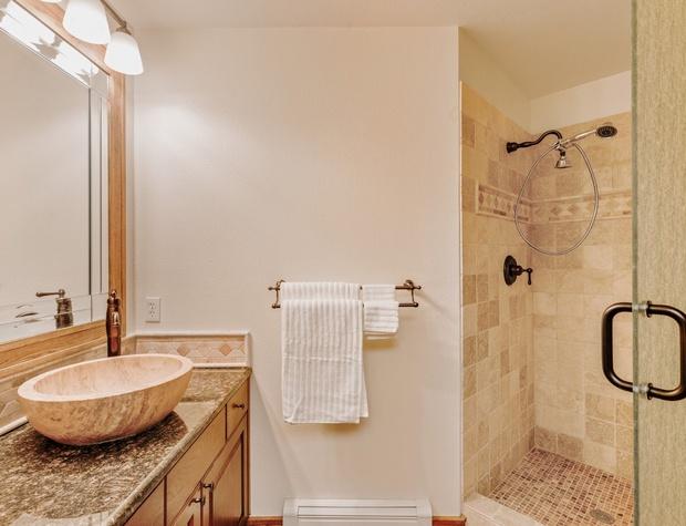 Bathroom with walk-in shower beside the first-floor bedroom.