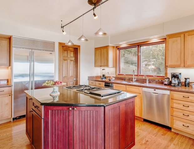 The kitchen provides ample counter space, a SubZero fridge, a gas stove with 4 large burners plus grill top, and a wall oven that fits a 15-pound turkey. As well as a view for the chef, of course!