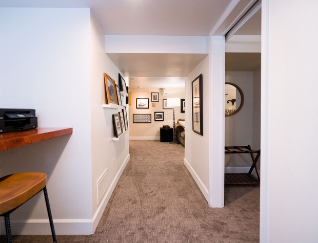 Spacious hallway leading into the living room from the dining area.