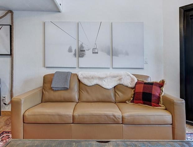 Sleeper Sofa with Memory Foam Mattress in Living Area