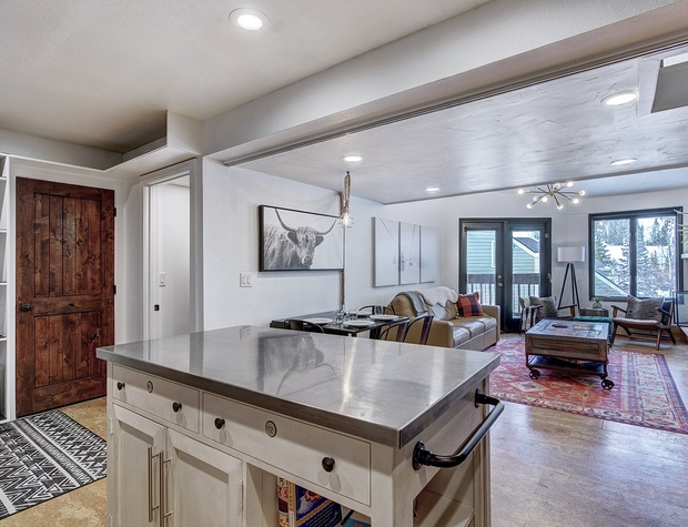 Kitchen Island, Dining Area, & Living Area