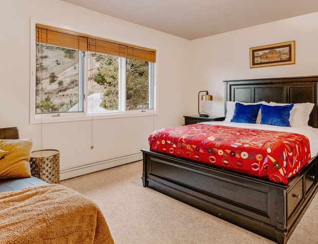 The first of two top-floor bedrooms features views to the south.
