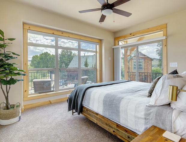 Master Bedroom with King Bed & Outdoor Deck with Seating