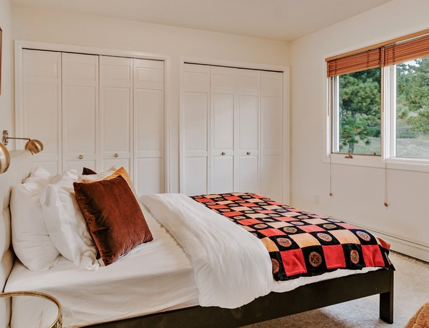 The second top-floor bedroom looks out to the north.