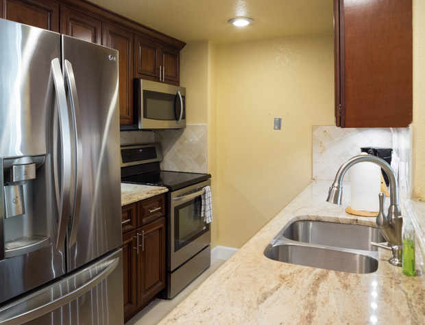 Remodeled kitchen with new stainless steel appliances