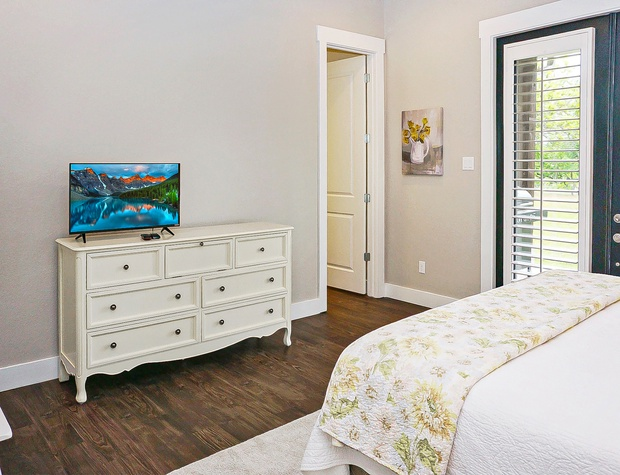The master bedroom also boasts a private TV and ensuite master bath