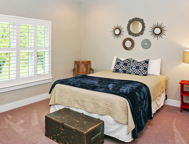 Upstairs guest bedroom with cozy queen sized bed.