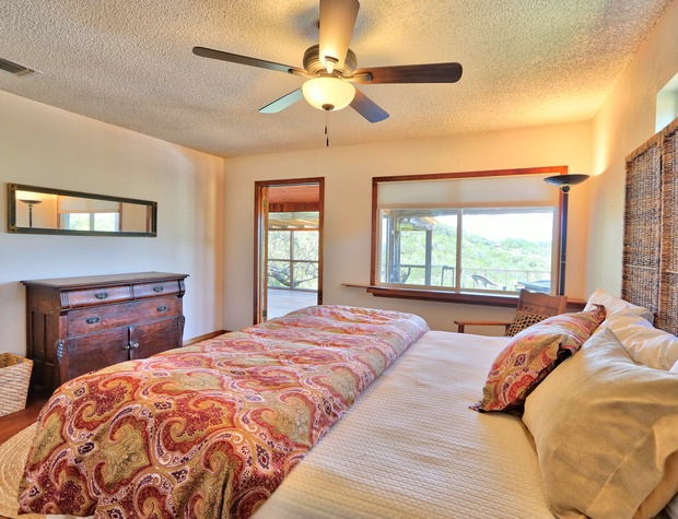 Master bedroom with king bed and direct access to the back deck!