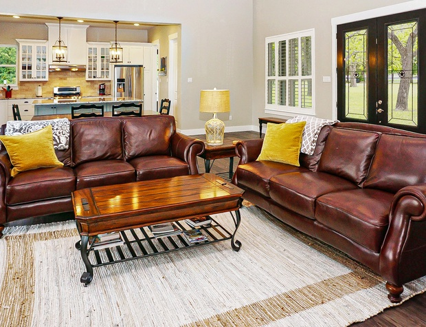 The living area has two comfortable couches and tons of natural light!
