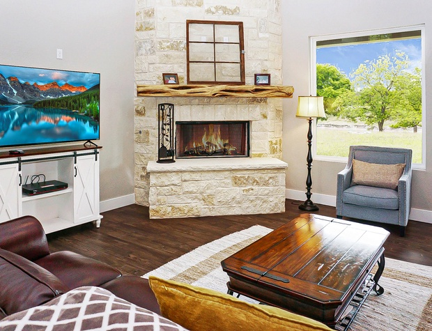 Beautiful stone fireplace in the living area.