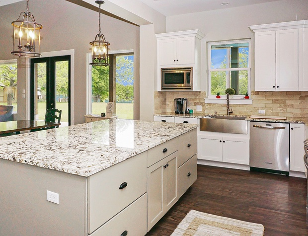 Full kitchen with open concept to dining and living areas