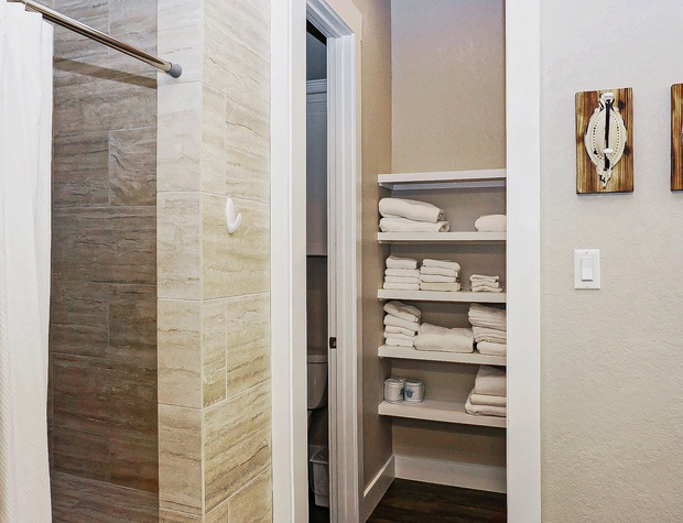 The master bath also has a walk in shower and separate water closet