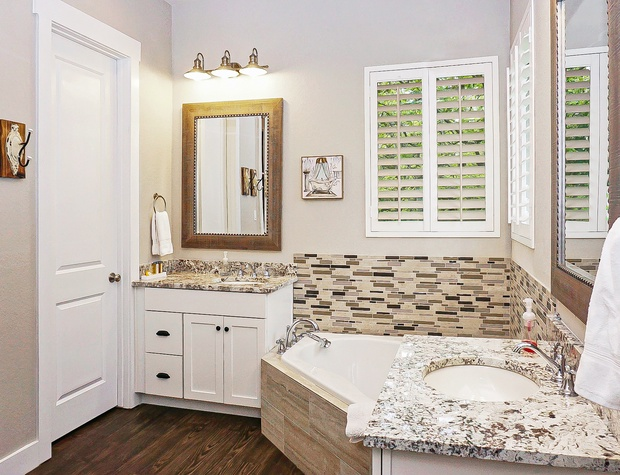 Gorgeous master bath with soaking tub and double vanities