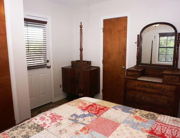 Bedroom 2 has private access to the backyard of the home as well as an entrance to the bathroom.