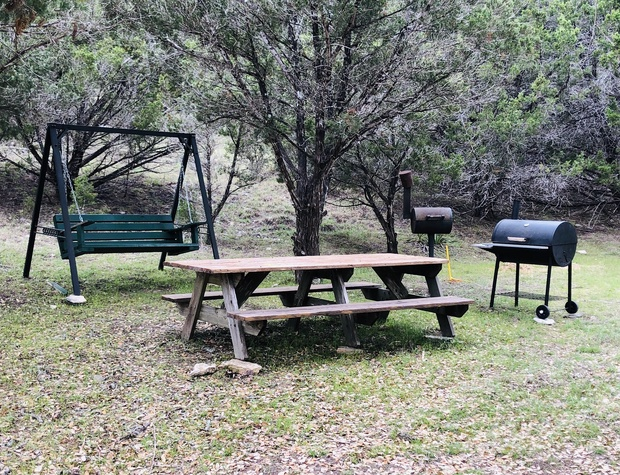 Outdoor picnic tables and charcoal grills