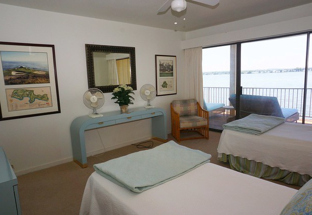 Two twin size beds with balcony access