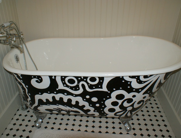 Custom designed claw foot tub with handheld shower attachment
