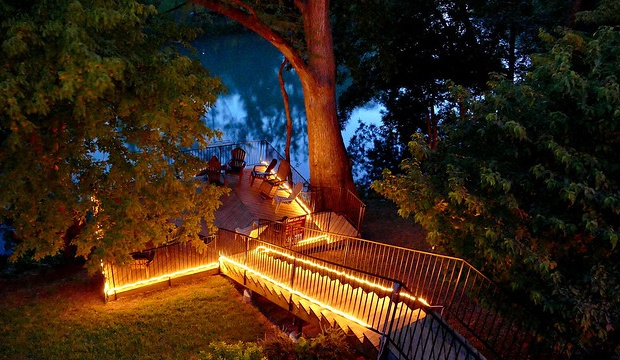 Steps to the river deck at night.