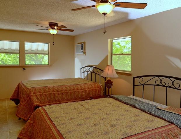 Two queen beds in bedroom